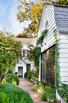 Designer Debbie and husband Beau Cummins' charming 1920s Dutch Colonial in Buckhead. The pretty metal doors were added during the renovation by Mike Hammersmith.