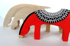 wooden horses, one painted red