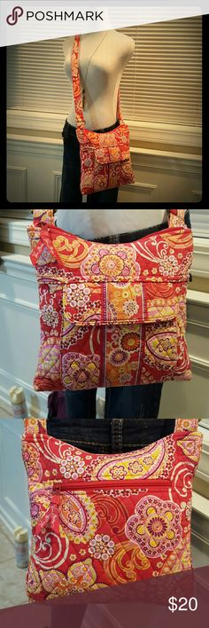 VERA BRADLEY Cross Body Medium Sized Hipster Type Medium sized VERA BRADLEY cross body hipster type handbag. Soft, cotton, lovely red/multi colored floral print. Well duhhh on me I mean it's  VERA BRADLEY, what do I expect? I could be describing all of her bags. Excellent used condition. Durable, washable. Slight fading/unevenness in coloring if you look very closely?(I have an extremely critical eye, I think there's something wrong with everything.)Snap pocket in front, zip in back. Large…