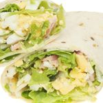 Mix together chopped eggs, mayonnaise and mustard. Add salt and pepper to taste.   Spread mixture on one rounded end of