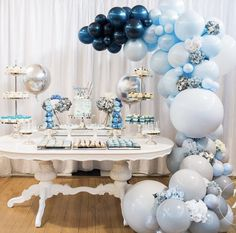 Blue balloon arch over food table. Party balloons.