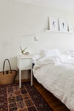 clean simple fresh white linen with rustic floor, basket, and rug. Scandinavian interiors