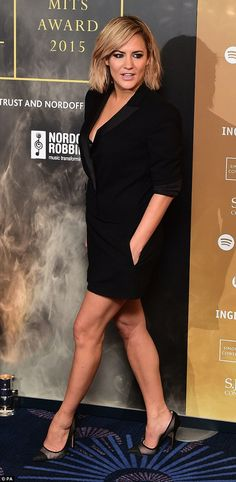 Strike a pose: Caroline held both hands in her pockets as she worked the angles in ablack...