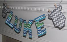 I don't really care for the name banner itself but I do love the blue and green chevron fabric for a crib skirt for baby boy!