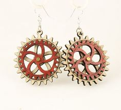 """Made in U.S.A Style # 5002F Size 1.65"""" x 1.5"""" Kinetic Gear Earring 5002F All Gears Move! Comes as shown -Natural Wood/Cherry Red Made from sustainably sourced materials Laser-cut wood Stained with water based dye Ear wires are silver-finished 3041 stainless steel with new electrophoretic-coating that resists tarnishing"""