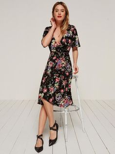 Easy breezy blah blah. This is a midi length, wrap dress with a v neckline and short sleeves.