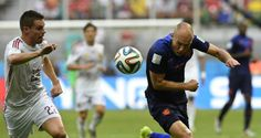 Spain's defence of the World Cup got off to the worst possible start when they were taken apart by the Netherlands in Salvador, surrendering an early lead and losing 5-1 in a repeat of the 2010 final...