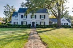 One of Anderson's most prestigious historical homes. Circa 1930 by CM Guest. This stately Georgian, white brick, 5 Bedroom, 5.5 Bath home in a tree lined park like garden on Anderson Heritage Tour of Homes, numerous garden tours, and North Anderson's National Register Historic District. Dream backyard with custom gunite lagoon-look pool/hot tub with waterfalls, stone patios, arbor with stacked stone fireplace, detached carriage house with 2 car garage, recreation room, bathroom, and bedroom…