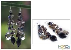 These stunning pearl earrings by Novica bring style to any outfit. Featuring beaded, dangle strands, these earrings have been handmade in Thailand with freshwater pearls and glass beads, making them an elegant addition to any jewelry collection.