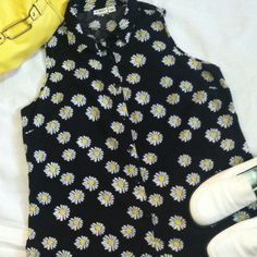 Flower Power Super cute tank top with Daisy print. Buttons up front has a collar and has cutout in back with straps across cutout. Really cute for summer time or layer it under blazer type coat etc. smoke free stain free material is 100%rayon and it is a size large . Made by Cato Cato Tops Tank Tops