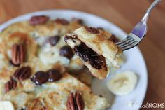 Turtle Pancakes.  Fluffy pancakes with chocolate chips, pecans and bananas inside.