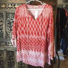 NWT long sleeve top with roll-up and button option Red and white silky fabric that has a vneck with drawstring detail. Sleeves are long unless rolled up and buttoned. Brand new with tags attached! Toomi Tops Blouses