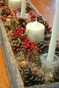 Christmas is coming, and now you must be busy with decorating your home for this big holiday. We want to enjoy a lot of delicious food at Christmas, so the Christmas Table Centerpieces Decoration is very necessary. A good Christmas table Centerpieces Christmas Table Centerpieces, Christmas Candles, Noel Christmas, Country Christmas, Winter Christmas, Magical Christmas, Pinecone Centerpiece, Centerpiece Ideas, Wedding Centerpieces