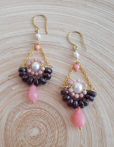 Youll adore the stop-and-stare beauty of these lovely Lotus gemstone trapeze earrings! Luminous accents of the focal freshwater pearl cast their light upon rich-hued garnet, while blush pink rhodochrosite faceted beads and a strawberry jade faceted drop briolette complement the