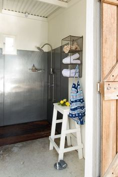 rustic cabin bathroom, metal shower walls, exposed plumbing shower, ladder