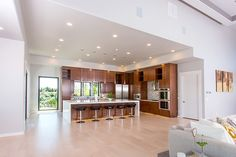 Oversized gourmet kitchen featuring built-in sub-zero fridge and freezer, stunning quartz waterfall island, hidden pantry, under cabinet LED lighting, gorgeous mosaic tile and breath taking views of the Rock Creek Canyon in Twin Falls. © Jason Lugo