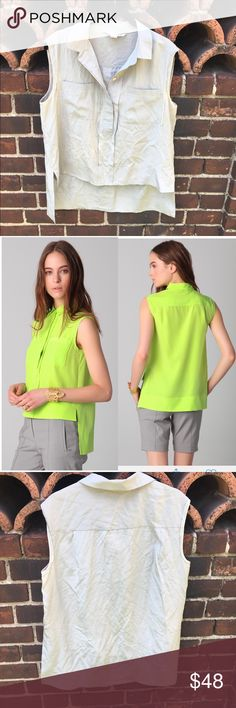 """Diane von Furstenberg Lensley Blouse Silver gray Sleeveless silk blouse features a fold over collar, hidden four button closure, front pockets and side slits. The hem is Asymmetrical and the material is Semi sheer. Measures 18""""inches armpit to armpit, 21""""inches in front and 28""""inches in back. 100% silk. 👚Silver gray one is for sale Diane Von Furstenberg Tops Blouses"""