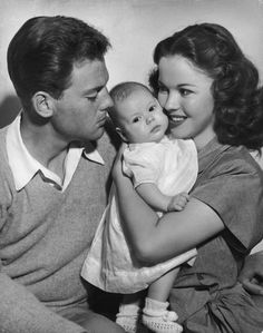 Shirley Temple and her first husband John Agar pose for a family portrait together with their three-month-old daughter Linda Susan in 1948.