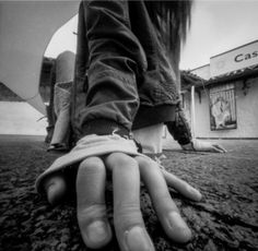 I like how the photo shows the hands just on the ground and creates a mood