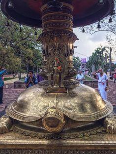 Statue of Vishnu, Kurma avatar at the base of Oil lamp tower Vadakkunnathan Shiva Temple, Thrissur, Kerala, India.