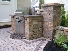 Why cook indoors when you can create your own outdoor kitchen? Solid retaining wall units can be easily cut to fit a grill or refrigerator and topped with a nice stone slab. Small Outdoor Kitchens, Outdoor Kitchen Design, Outdoor Spaces, Outdoor Living, Outdoor Decor, Outdoor Ideas, Patio Ideas, Bbq Ideas, Diy Patio