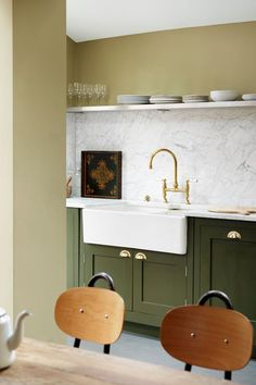 We saw so many beautiful kitchen trends in 2016: tons of marble, rich blue and black cabinets, open shelving, and a mix of materials. While we don't think these things will disappear overnight, we definitely see a shift ahead. If you're thinking about redoing your kitchen soon, or are just design curious, read on for what you can expect to see more of in the coming year, and why we think that's the case.