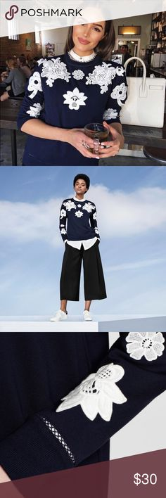 { New } Navy & Floral Appliqué Sweater Brand New With Tags Navy Sweater with White Appliqué Sweater. Great for the fall & winter season. Pairs perfect with your favorite jeans & booties. Victoria Beckham for Target Sweaters Crew & Scoop Necks