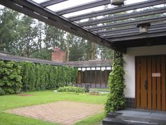 The courtyard of Alvar Aalto's Town Hall at Saynatsalo, Finland, 1952.  It has a courtyard like many of his buildings (his own studio in Helsinki, his lake house at Muuratsaalo).  He loved Italian architecture deeply and adapted the courtyard for use in some of his Finnish buildings, which some criticized him for as being inappropriate to the snowy climate.  However, I found his courtyards to be absolutely beautiful and peaceful.