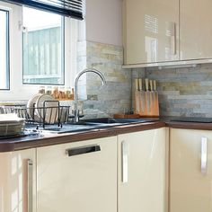 Hi-gloss cream kitchen   Slate wall tiles, Kitchen pictures and Kitchens