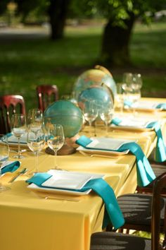 Turquoise blue and mustard yellow tablescape, globes and maps tablescape.