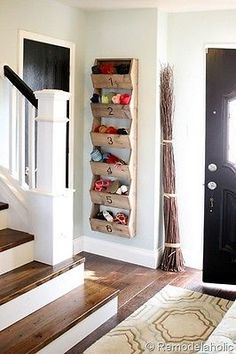 Use slim wall bins to store toys and shoes in any small space. (image: Remodelaholic)