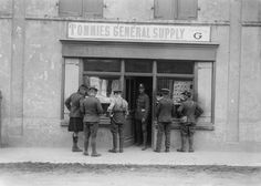 """Brit WWI Slang - """"Tommies"""" Short for Thomas Atkins, a name widely used by journalists to denote a private soldier. It seems to have originated from a Thomas Atkins who mythically distinguished himself at the Battle of Waterloo in 1815. It was rarely used by British troops themselves, unless derisively.  """"Tommies General Supply shop in the village of Ghyvelde, near Dunkerque, August 1917."""""""