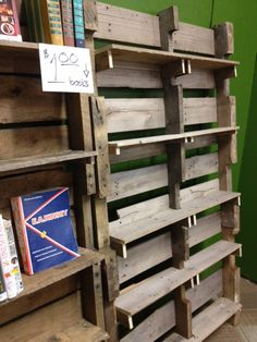 Awesome pallet shelving I saw in a store.  It leans against and is bolted to wall.  Bottom is beveled to accomodate the lean.  I offered to purchase but store manager wouldn't part w/ it so I'm going to have to make my own (no tutorial linked here- I just wanted to save the image for future reference).