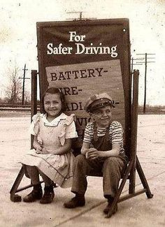 Collierville, Tennessee - Bobby Ballard and his sister in front of their family gas station.