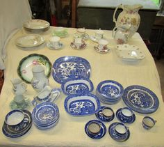 """Antique and vintage pottery and porcelain including two New Whare Pottery pitchers (11"""" and 6.5""""T); numerous pieces of vintage Allertons Pottery Blue Willow dinnerware; several English bone china cups and saucers; 7""""T Villeroy & Boch vase and 4""""T creamer; Austrian bowls; etc."""