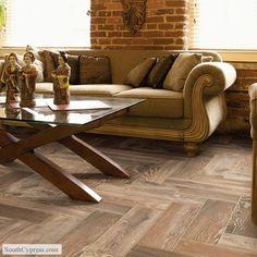 love the herringbone pattern on these wood-look tile floors