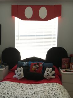 Disney-themed room:  Mickey Mouse ears headboard with Mickey Mouse belt window valance. Using foam board, batting, fabric and lots of duct tape.