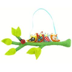 Beautiful hand-felted in Nepal, this hanging felt decoration has four owls on a branch and hangs from a 20-inch long ribbon. Each owl is accented with upcycled sari fabric making each piece truly unique, The branch is approximately 16 inches long. #handmaddemobile