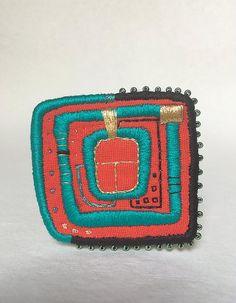 Brooch with Hundertwasser motives. I love Hundertwasser arts and I am pretty much inspired by his works. Those brooches are embroidered. Each brooch is handmade and ooak.   ca 6 x 6,5 cm - 2,3 x 2,5 inches  *************************************************************  ENTER MY SHOP HERE TO SEE ALL ITEMS at: https://www.etsy.com/shop/MakikoArt   FACEBOOK: https://www.facebook.com/makiko.at  INSTAGRAM: https://instagram.com/makikoart/  www.makiko.at    Thanks for looking! makiko