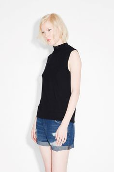 With a ribbed turtleneck, this mad elegant sleeveless number can go anywhere with you. And cut from a nylon blend fabric, it is so amazingly crazy soft.