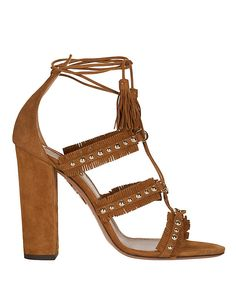 Aquazzura Tulum Grommet Lace-Up Sandal: Brown: Fringed leather straps are detailed with gold-tone metal grommets. Lace-up wraps around leg. Block 4 1/2 heel. Leather soles. In brown suede. Made in ...