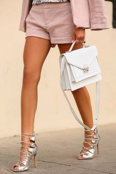 womens street style fashion: pink linen shorts and blazer jacket, metallic silver lace up heels, white leather bag (pd)