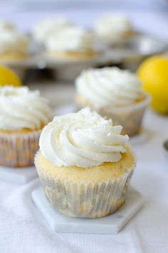 Great idea! Recipe for vanilla cupcakes stuffed with lemon curd and topped with lemon buttercream!