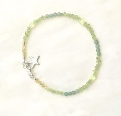 Now selling: Peridot Anklet, Green Gemstone Beach Anklet with Aventurine and Czech Glass https://www.etsy.com/listing/457675376/peridot-anklet-green-gemstone-beach?utm_campaign=crowdfire&utm_content=crowdfire&utm_medium=social&utm_source=pinterest
