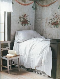 Love the style and height of this bed, and the lovely wall treatment