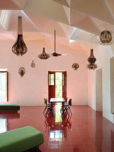 Pink dining room in the Tecoh, Mexico home of artist Jorge Pardo