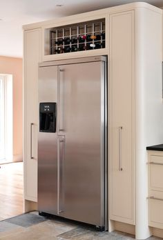 An example of a housing for an American fridge-freezer with pull-out larders and oak wine rack. American Fridge Freezer Built In, American Fridge Freezers, Kitchen Organisation, Kitchen Storage, Freezer Storage, Refrigerator Storage, Kitchen Living, New Kitchen, Big Fridge