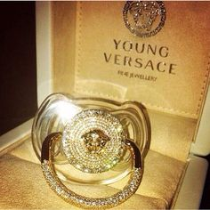 Gold pacifier from Versace