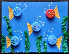 I HEART CRAFTY THINGS: Bottle Cap Art (Fish and Flower Scene)