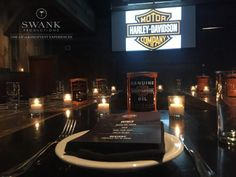 Setting Planned, Produced & Designed by: www.swankproductions.com   #Events #Design #table #setting #motor #name #Brand #orange #wood #bar #theme #harley #davidson #ideas #inspiration #decor #corporate #party #fun #camdles #dark #logo #menu